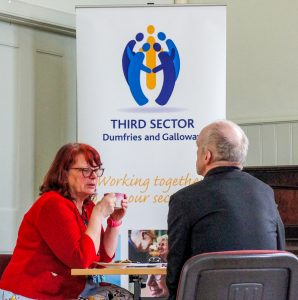 Engagement Officer Christine Clarke in a one-to-one at a support roadshow.